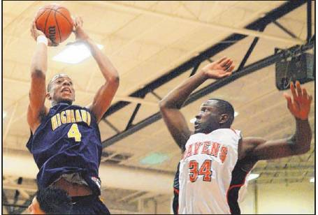 ROBERTO E. ROSALES/JOURNAL Chad Adams (4) of Highland goes up for a shot against Rio Grande's Brian Twitty on Friday night. Adams had 32 points.