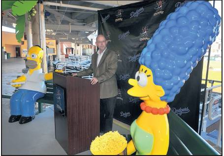 ROBERTO E. ROSALES/JOURNAL Isotopes GM John Traub has brought in statues of Homer and Marge Simpson. They will be at Isotopes Park where fans can take pictures with the cartoon characters.